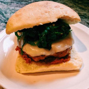 sausage burgers with garlicky spinach