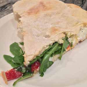 sicilian stuffed pizza with ricotta and arugula